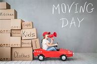 Child moving day in car with boxes