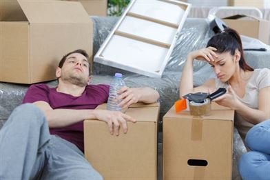Couple are tired of packing boxes for house clearance