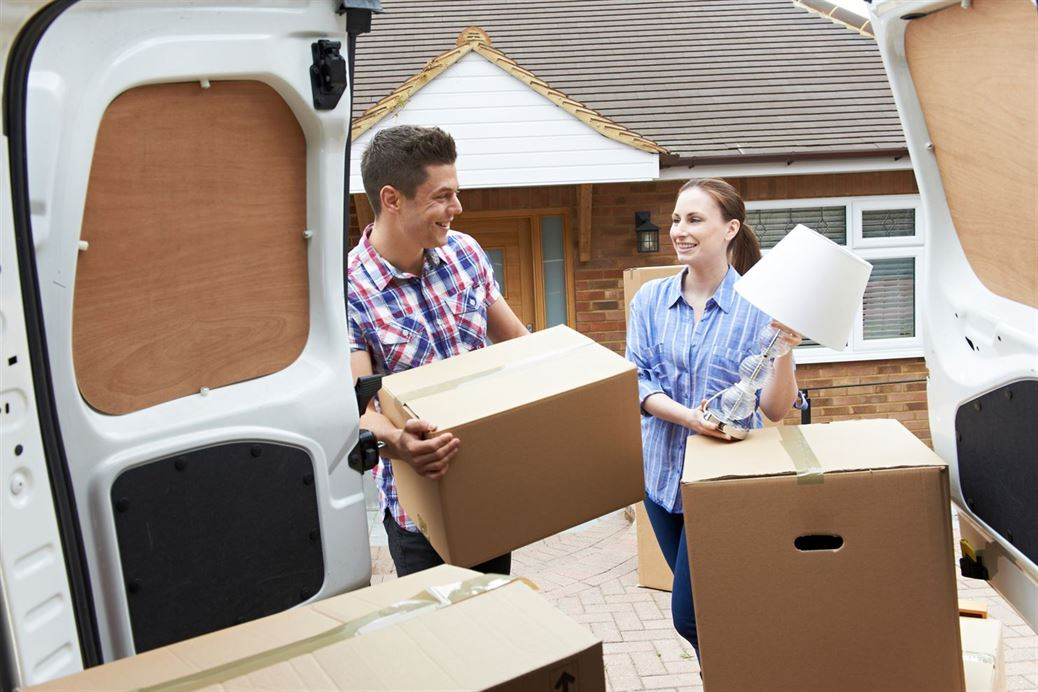 Couple filling van with boxes